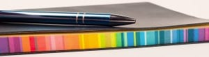 Rainbow notwbook and pen image